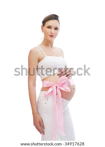 Isolated pregnant woman with pink ribbon - stock photo