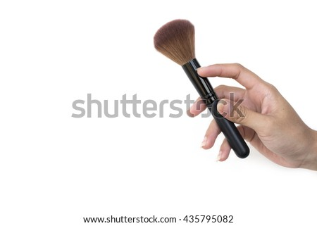 isolated professional makeup brush in women's hand