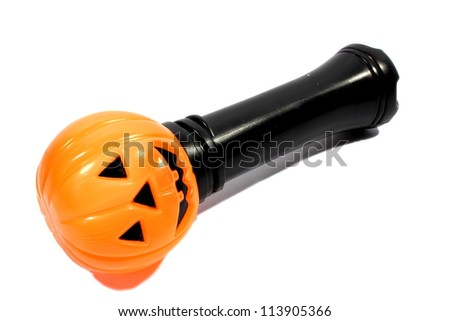 Isolated pumpkin flashlight used by trick or treaters. - stock photo
