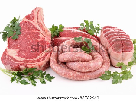 isolated raw meat and parsley