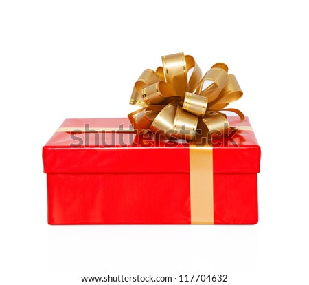 Isolated red gift box with a gold bow on New Year holiday
