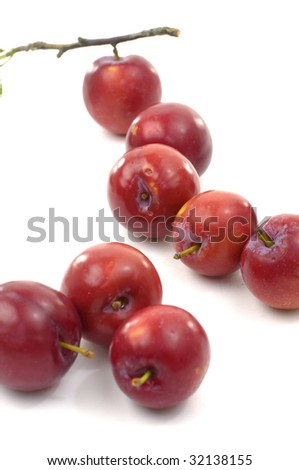 Isolated red sweet red plums