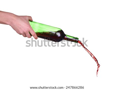 Isolated red wine is poured from a bottle - stock photo