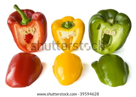 Isolated red, yellow and green paprika on a white background.