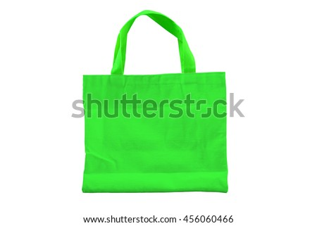 Isolated reuseable green fabric bag for environment conservation campaign and for shopping.