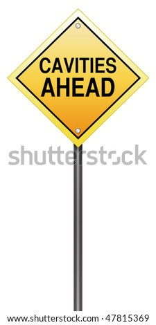 "Isolated Road Sign Metaphor with ""Cavities Ahead"""