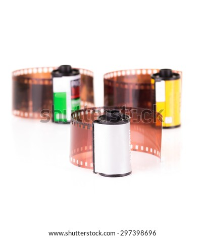 isolated roles of 35 mm negative film - stock photo