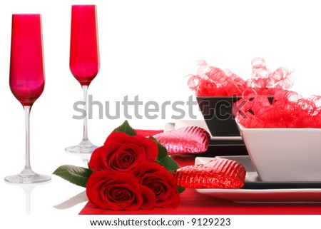 Isolated; Romantic Modern Black & White Table Setting ~ Red Champagne Flutes with Fresh Red Roses - stock photo