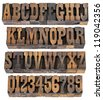 isolated rows of letters and numbers in vintage letterpress wood type blocks, French Clarendon font popular in western movies and memorabilia - stock photo