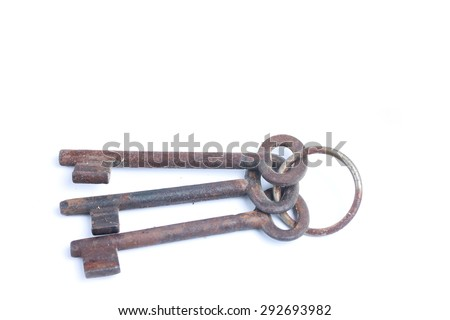 Isolated rusty old keys on key ring - stock photo