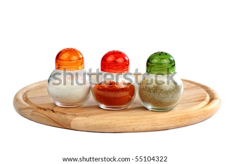 Isolated salt, black pepper, red pepper boxes  on wooden plate on white background cellar - stock photo