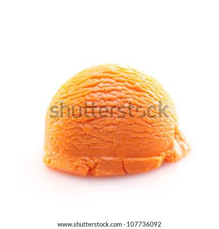Isolated scoop of orange ice cream isolated on white background - stock photo