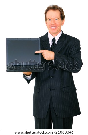 isolated senior business male holding and pointing at laptop with happy expression