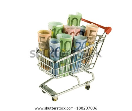 Isolated shopping cart with euro banknotes. - stock photo