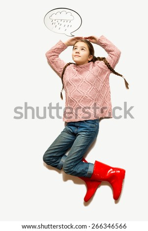 Isolated shot from top of cute girl lying on floor and covering from drawn rain - stock photo