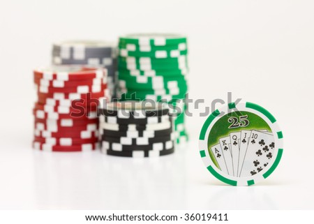 Isolated shot of a poker chips, with stacks of poker chip as the background