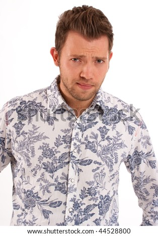 Isolated shot of a Young man with an arrogant gesture - stock photo