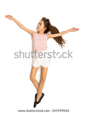 Isolated shot of cute smiling girl in skirt doing ballet pas - stock photo