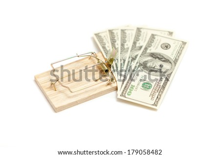 Isolated shot of mouse trap with money as bait - stock photo