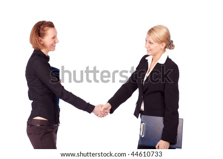 isolated shot of two businesswomen shaking hands - stock photo