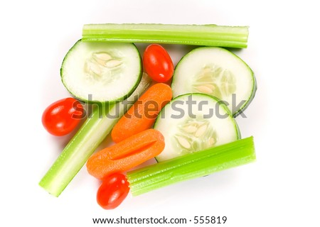 Isolated shot of wet vegetable sticks on a white background. - stock photo