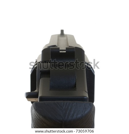 Isolated sights on a handgun that are aligned to hit a target - stock photo