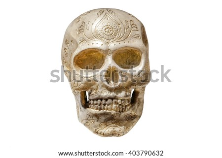 Isolated skull on white background with carved ornaments - stock photo