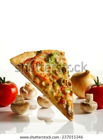 Isolated slice of pizza with ingredients - stock photo