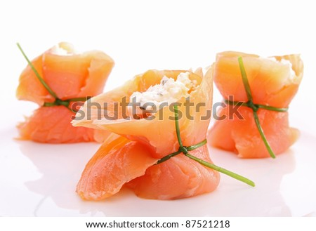 isolated smoked salmon roll with cheese on white background - stock photo