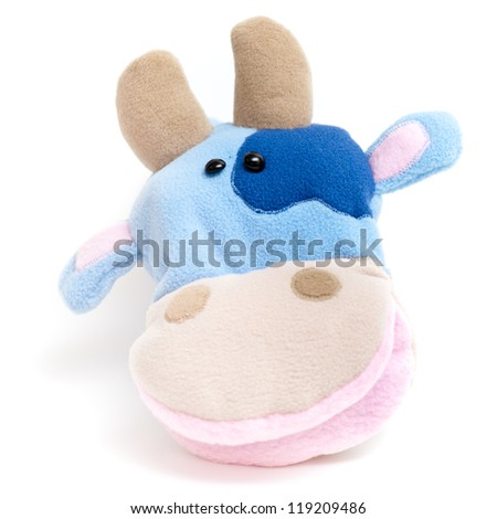 Isolated soft hand puppet (farm animal: cow) - stock photo
