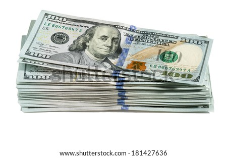 Isolated stack of new design of US currency one hundred dollar bills laid out on table with focus on Ben Franklin portrait