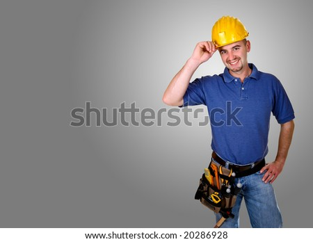 Isolated standing young worker with space for text - stock photo