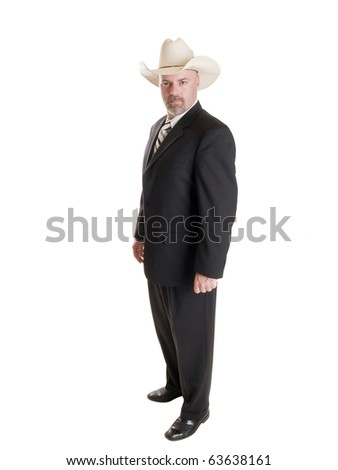 Isolated stock photo of a serious caucasian businessman looking at the camera while wearing a suit and cowboy hat. - stock photo