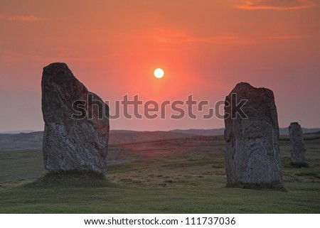 Isolated stones and sunset in Callanais
