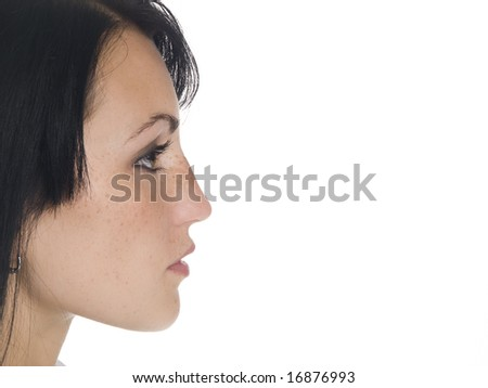Isolated studio head shot of a woman's profile.