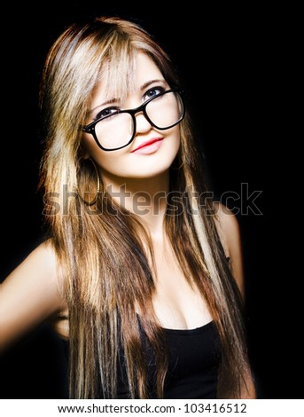 Isolated studio picture of a pretty female admin clerk or personal assistant wearing glasses on black background