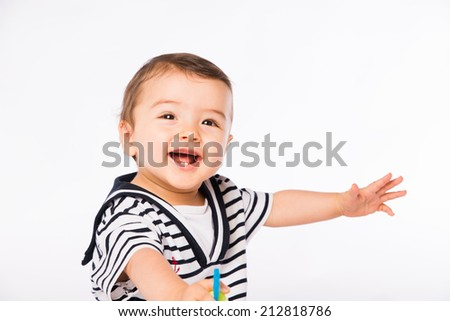 isolated studio portrait on white background of lovely toddler baby boy playing and laughing
