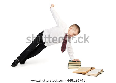 Isolated studio portrait on white background, school boy doing sport exercises while study books - stock photo