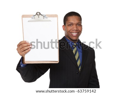 Isolated studio shot of a businessman filling out a questionnaire on a clipboard. - stock photo