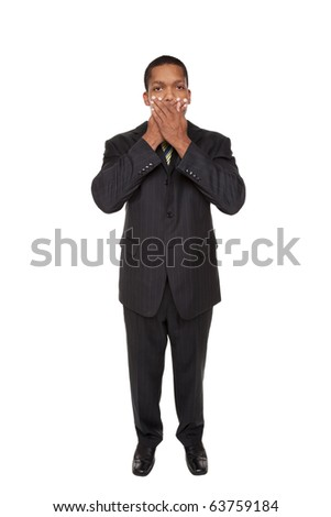 Isolated studio shot of a businessman in the Speak No Evil pose.