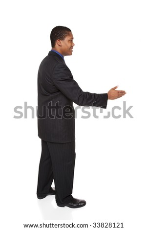 Isolated studio shot of a businessman reaching out to shake hands. - stock photo