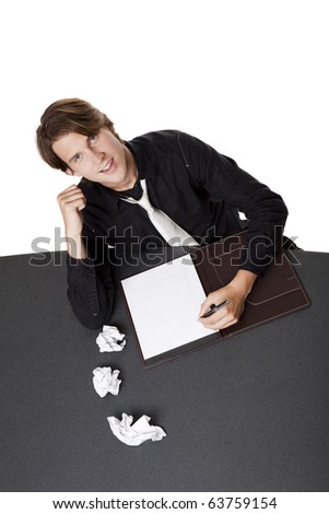 Isolated studio shot of a businessman suffering from writers block succeeding after several failed starts. - stock photo