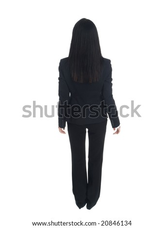 Isolated studio shot of a businesswoman from behind