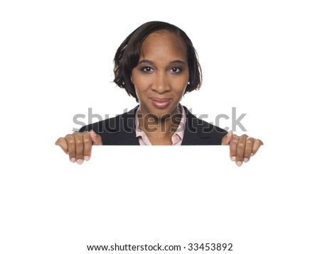 Isolated studio shot of a businesswoman holding a big blank sign. - stock photo