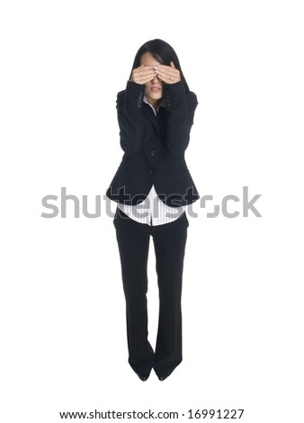 Isolated studio shot of a businesswoman in the See No Evil pose.