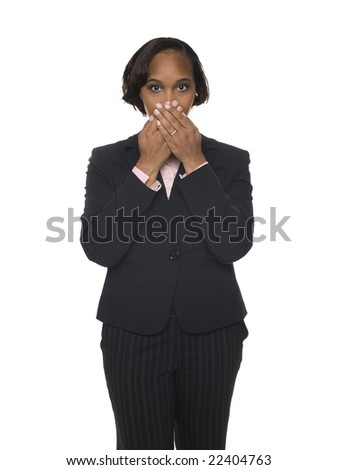 Isolated studio shot of a businesswoman in the Speak No Evil pose.