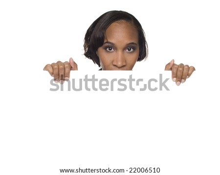 Isolated studio shot of a businesswoman looking over the edge of a blank sign. - stock photo