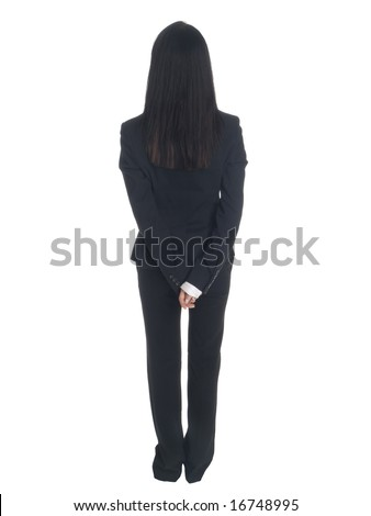 Isolated studio shot of a businesswoman standing with her hands clasped behind her back. - stock photo