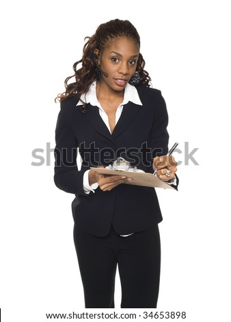 Isolated studio shot of a businesswoman wearing a headset telephone and writing on a clipboard. - stock photo