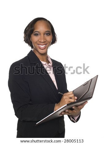 Isolated studio shot of a businesswoman writing on a notepad. - stock photo